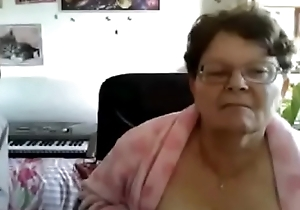 Beaming granny from webcamhooker.us big buxom titties